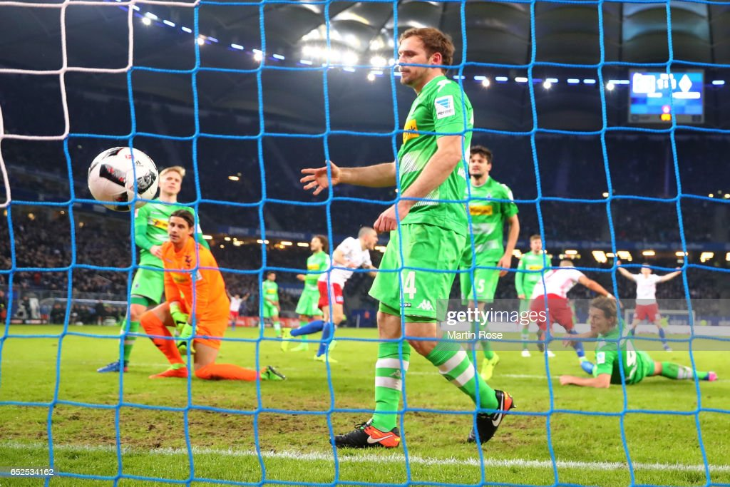Jannik Vestergaard (C) of Moenchengladbach reacts after receiving the 2nd goal with his team mates during the Bundesliga match between Hamburger SV and Borussia Moenchengladbach at Volksparkstadion on March 12, 2017 in Hamburg, Germany.
