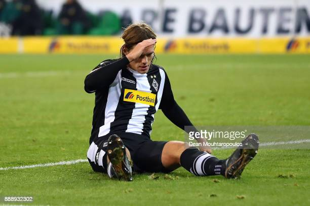 Jannik Vestergaard of Moenchengladbach reacts on the pitch after he scored an own goal to make it 11 during the Bundesliga match between Borussia...