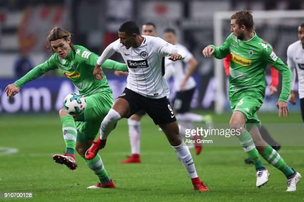 Jannik Vestergaard of Moenchengladbach , Sebastien Haller of Eintracht Frankfurt and Christoph Kramer of Moenchengladbach battle for the ball during...