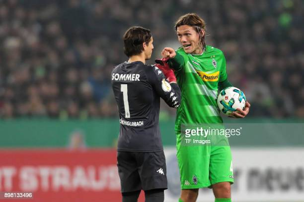 Jannik Vestergaard of Moenchengladbach speaks with Goalkeeper Yann Sommer during the DFB Cup match between Borussia Moenchengladbach and Bayer...