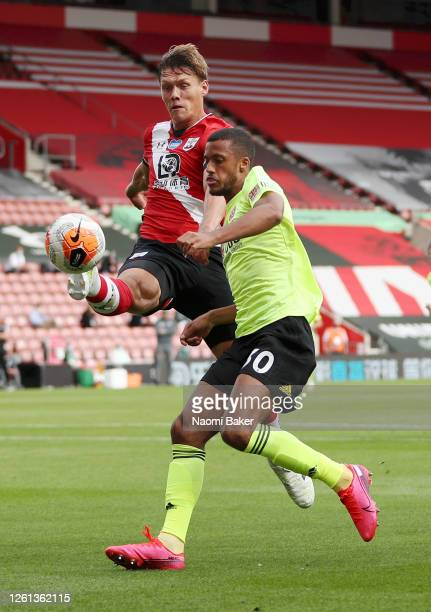Jannik Vestergaard of Southampton battles for possession with Richairo Zivkovic of Sheffield United during the Premier League match between...
