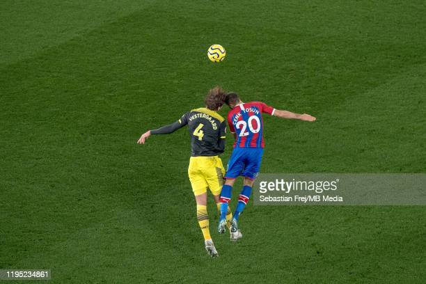 Jannik Vestergaard of Southampton FC and Cenk Tosun of Crystal Palace jump for ball during the Premier League match between Crystal Palace and...