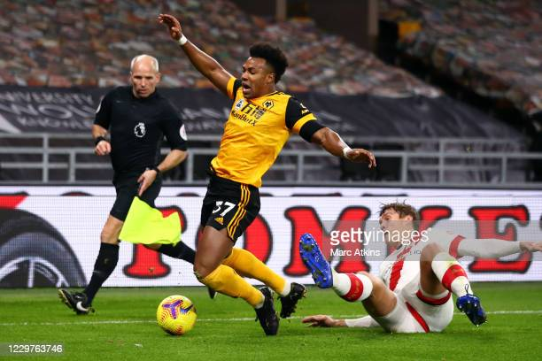 Jannik Vestergaard of Southampton fouls Adama Traore of Wolverhampton Wanderers during the Premier League match between Wolverhampton Wanderers and...