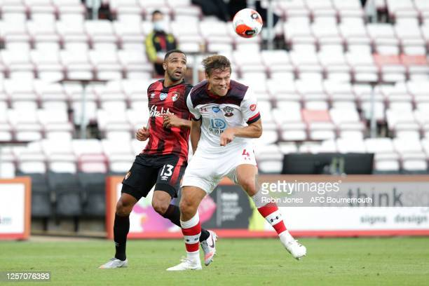 Jannik Vestergaard of Southampton heads clear of Callum Wilson of Bournemouth during the Premier League match between AFC Bournemouth and Southampton...