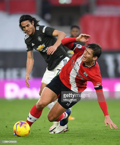 Jannik Vestergaard of Southampton is fouled by Edinson Cavani of Manchester United during the Premier League match between Southampton and Manchester...