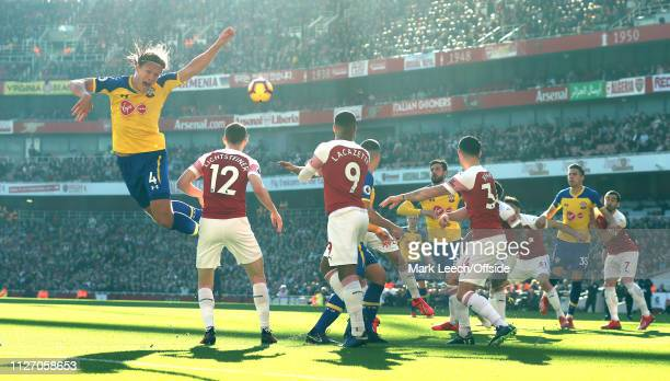 Jannik Vestergaard of Southampton makes a leap but misses the ball at a corner kick during the Premier League match between Arsenal FC and...