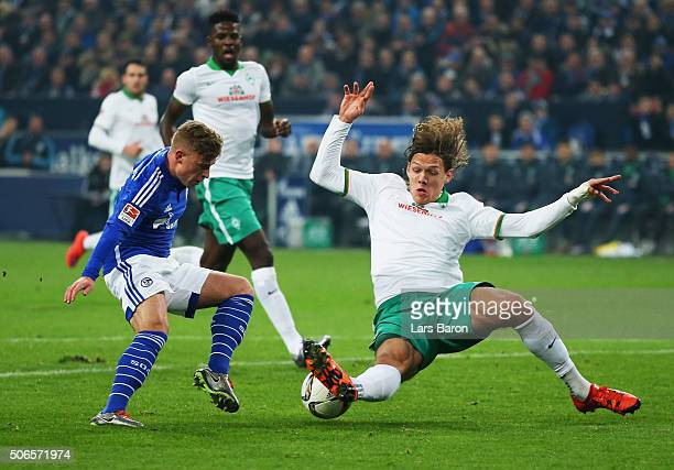 Jannik Vestergaard of Werder Bremen slides to tackle Max Meyer of Schalke during the Bundesliga match between FC Schalke 04 and Werder Bremen at...