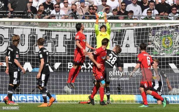 Jannik Vestergaard Patrick Herrmann of Borussia Moenchengladbach Karim Rekik of Hertha BSC Yann Sommer of Borussia Moenchengladbach Niklas Stark of...