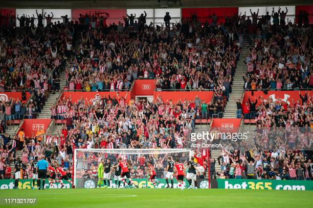 Jannik Vestergard of Southampton celebrates scoring their first goal during the Premier League match between Southampton FC and Manchester United at...