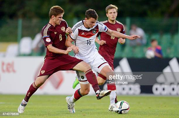 JanniLuca Serra of Germany U17 challenges Georgi Makhatadze of Russia U17 during the UEFA European Under17 Championship Semi Final match between...