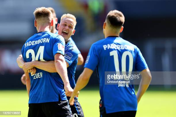 Jannis Heuer of Paderborn celebrates the second goal with his team mates during the pre-season match between SC Paderborn and Borussia...