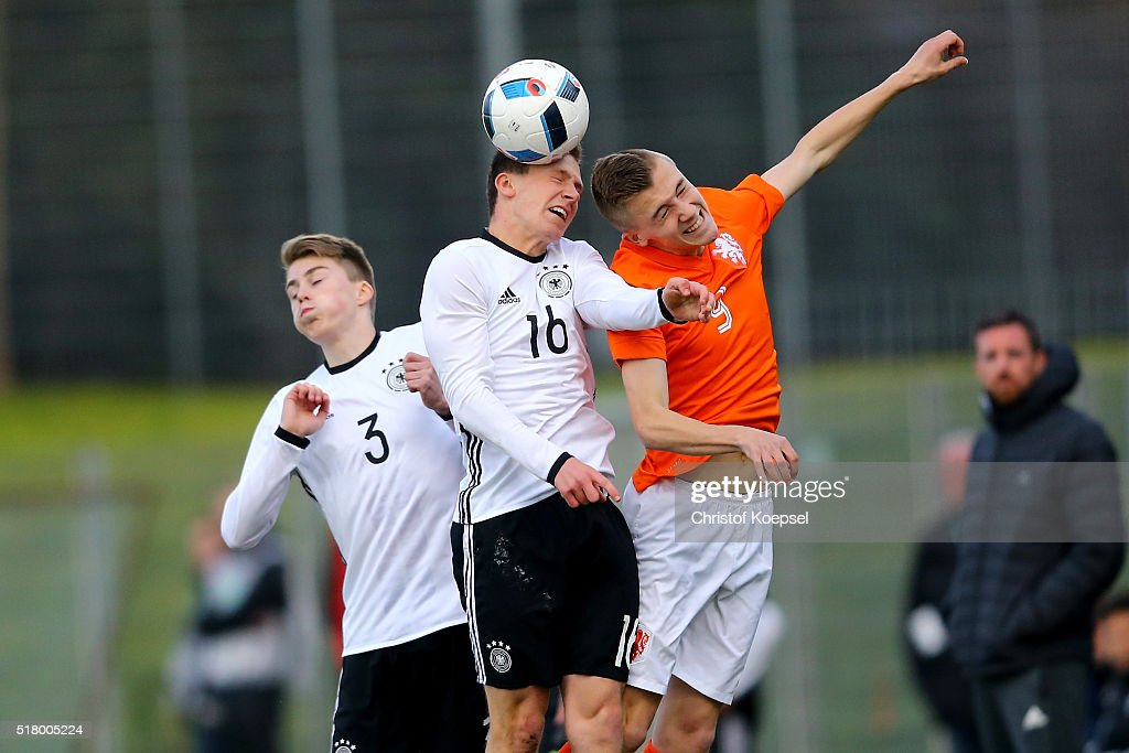 Jannis Kuebler of Germany and Dylan vente of the Netherlands go up for a header during the U17 Euro Qualification match between Germany and Netherlands at Paul Janes Stadium on March 29, 2016 at Esprit-Arena in Duesseldorf, Germany.