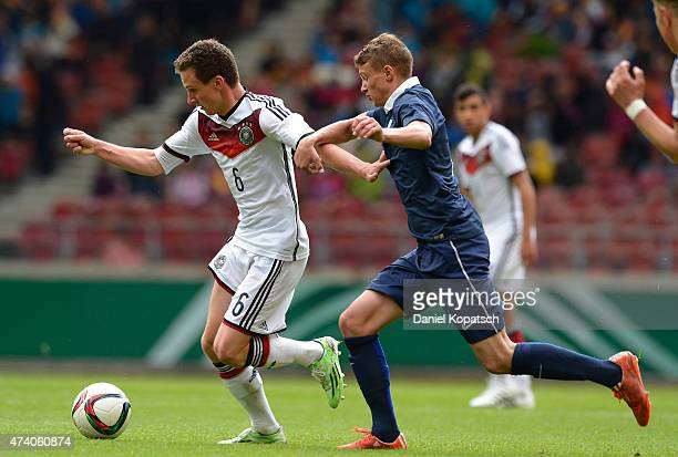 Jannis Kuebler of Germany is challenged by Mickael Cuisance of France during the International Friendly match between U16 Germany and U16 France at...
