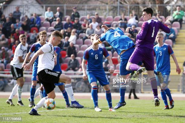 Jannis Lang of Germany U17 tries to score past goalkeeper Olafur Kristofer Helgason of Iceland U17 during the UEFA Elite Round match between Germany...