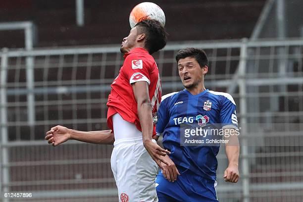Jannis Nikolaou of RW Erfurt challenges Aaron Seydel of FSV Mainz 05 II during the Third League match between 1FSV Mainz 05 II and RW Erfurt at...