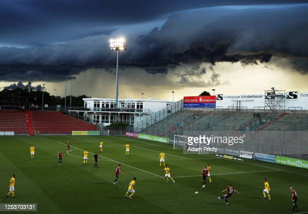 Jannis Turtschan of SpVgg Unterhaching controls the ball while a massive shelf cloud rolls in during the 3 Liga match between SpVgg Unterhaching and...