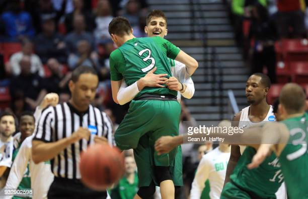 Jannson Williams and Ajdin Penava of the Marshall Thundering Herd celebrate after defeating the Wichita State Shockers during the first round of the...