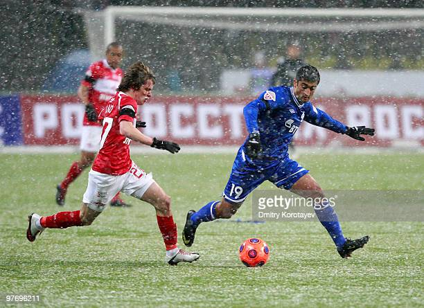 Jano Ananidze of FC Spartak Moscow battles for the ball with Aleksandr Samedov of FC Dynamo Moscow during the Russian Football League Championship...