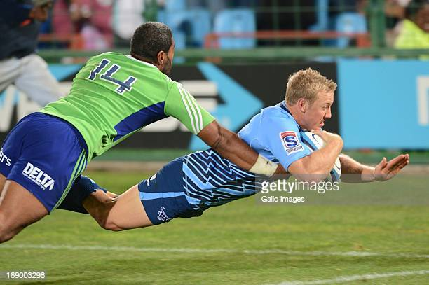 Jano Vermaak of Bull scores during the Super Rugby match between Vodacom Bulls and Highlanders from Loftus Versfeld on May 18 2013 in Pretoria South...