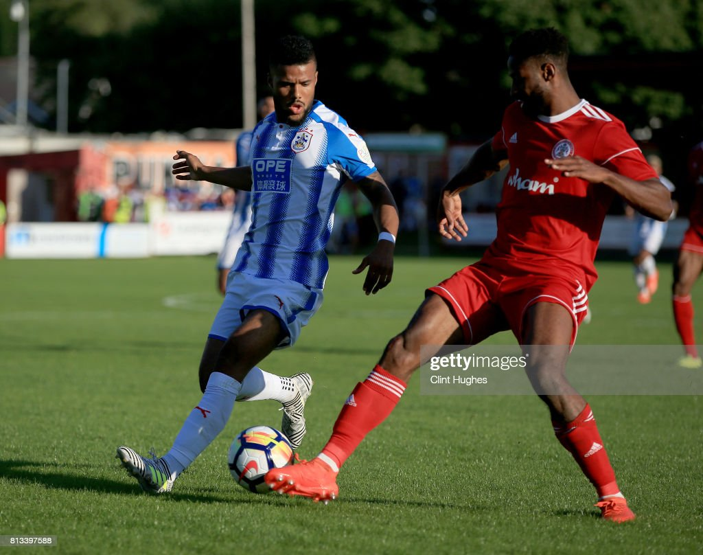 Janoi Donacien (R) of Accrington Stanley and Elias Kachunga of Huddersfield Town battle for the ball during the pre season friendly game at Wham Stadium on July 12, 2017 in Accrington, England.