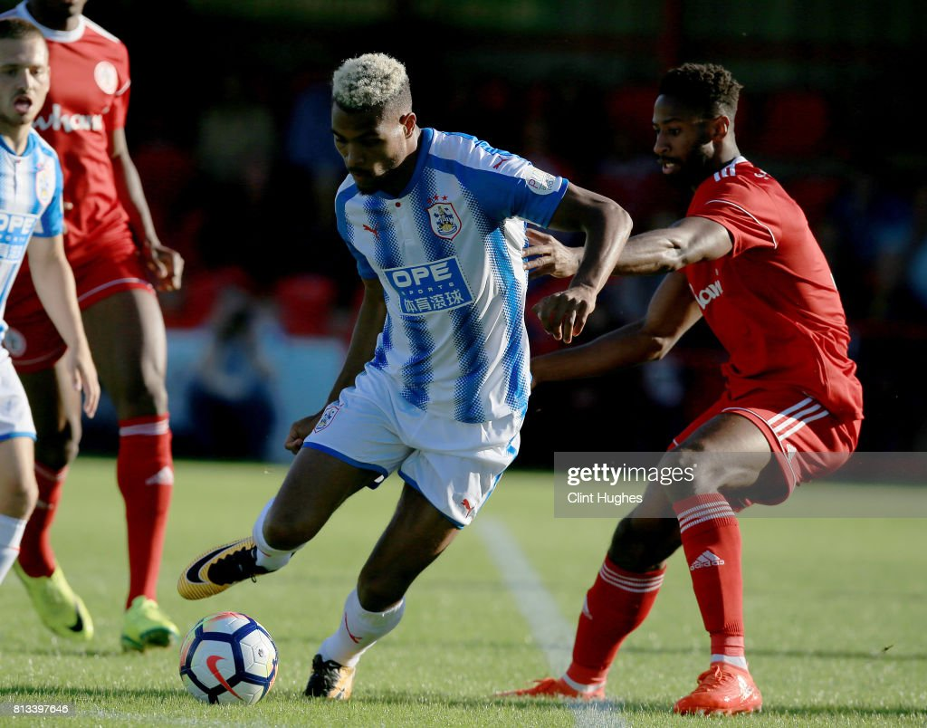 Janoi Donacien (R) of Accrington Stanley and Steve Mounie of Huddersfield Town battle for the ball during the pre season friendly game at Wham Stadium on July 12, 2017 in Accrington, England.