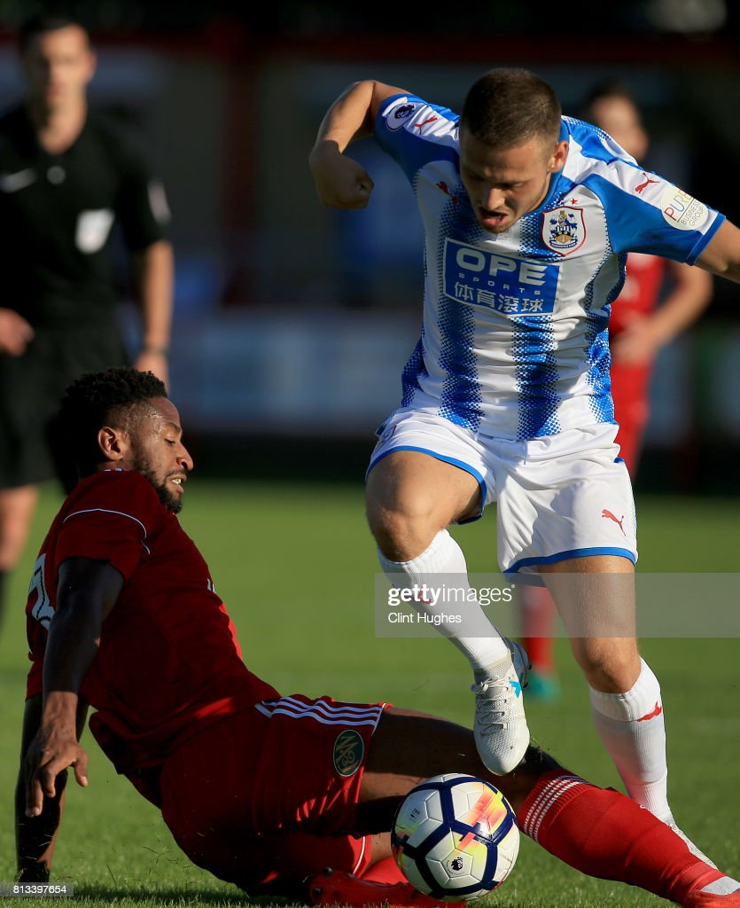 Janoi Donacien (L) of Accrington Stanley tackles Jack Payne of Huddersfield Town during the pre season friendly game at Wham Stadium on July 12, 2017 in Accrington, England.