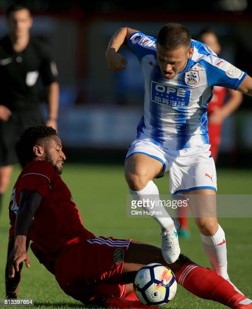 Janoi Donacien of Accrington Stanley tackles Jack Payne of Huddersfield Town during the pre season friendly game at Wham Stadium on July 12 2017 in...