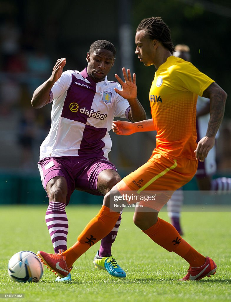 Janoi Donacien (L) of Aston Villa in action during the Pre Season Friendly match between Wycombe Wanderers and Aston Villa at Adams Park on July 20, 2013 in High Wycombe, England.