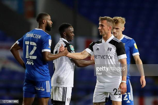 Janoi Donacien of Ipswich Town shakes hands with Joe Bryan of Fulham following the Carabao Cup Second Round match between Ipswich Town and Fulham at...