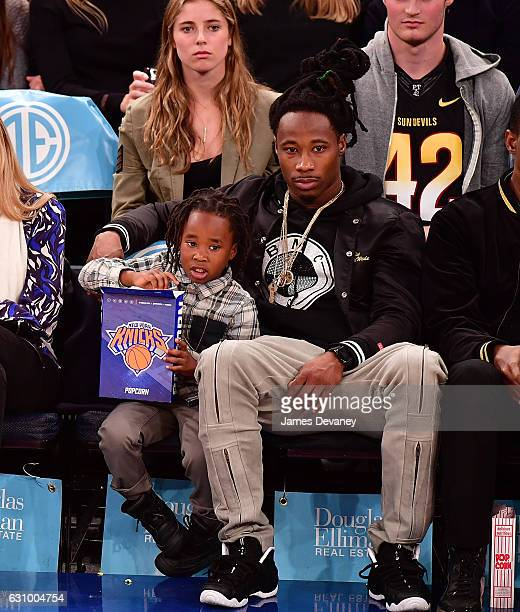 Janoris Jenkins and his son attend Milwaukee Bucks vs New York Knicks game at Madison Square Garden on January 4 2017 in New York City