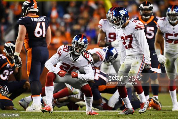 Janoris Jenkins of the New York Giants and Darian Thompson celebrate a fumble recovery against the Denver Broncos during the fourth quarter of the on...