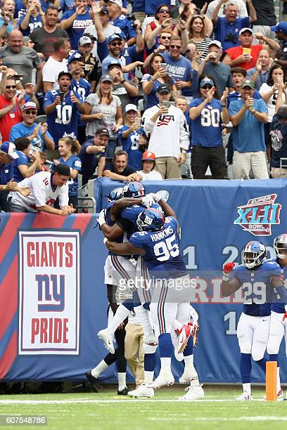 Janoris Jenkins of the New York Giants celebrates his 65yard touchdown with teammate Devon Kennard and Johnathan Hankins during second quarter...