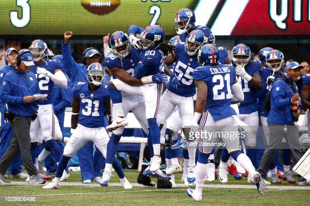 Janoris Jenkins of the New York Giants celebrates with teammates after an interception in the first quarter against the Jacksonville Jaguars at...