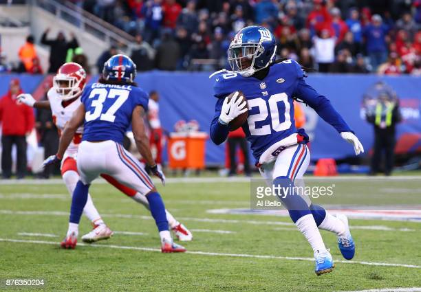 Janoris Jenkins of the New York Giants runs back an interception in the fourth quarter against the Kansas City Chiefs during their game at MetLife...