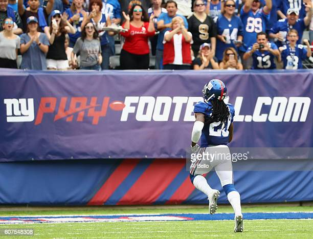 Janoris Jenkins of the New York Giants runs in a 65yard touchdown during second quarter against the New Orleans Saints at MetLife Stadium on...