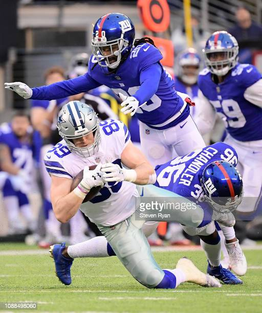 Janoris Jenkins of the New York Giants tackles Blake Jarwin of the Dallas Cowboys at MetLife Stadium on December 30 2018 in East Rutherford New Jersey