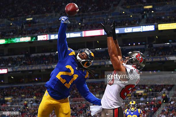 Janoris Jenkins of the St Louis Rams breaks up a touchdown pass intended for Vincent Jackson of the Tampa Bay Buccaneers at the Edward Jones Dome on...