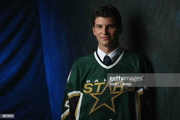 Janos Vas second draft pick in the second round selected by the Dallas Stars poses for a portrait during the NHL Entry Draft on June 22 2002 at the...