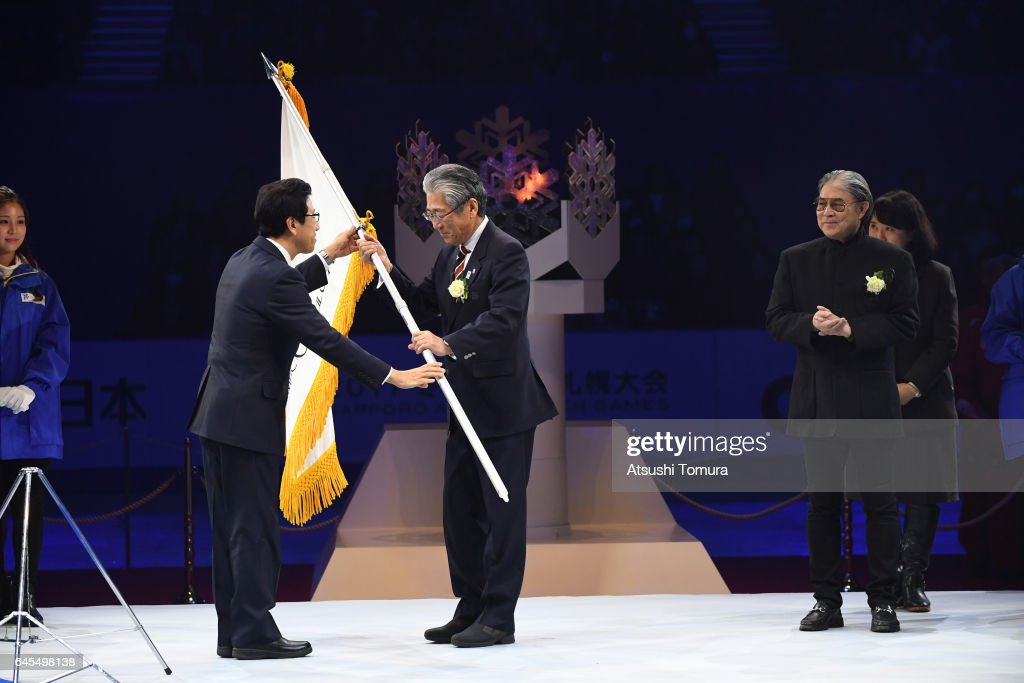 Janpan Olympic committee president Tsunekazu Takeda accepts the Asian games flag from President of the organising committee Katsuhiro Akimoto the closing ceremony on the day nine of the 2017 Sapporo Asian Winter Games at Makomanai indoor skating rink on February 26, 2017 in Sapporo, Japan.