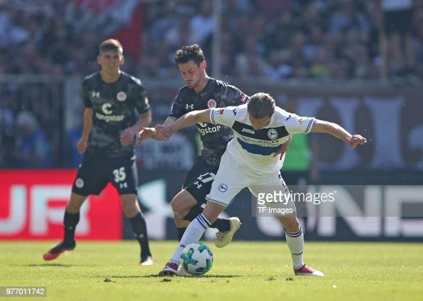 JanPhilipp Kalla of St Pauli and Konstantin Kerschbaumer of Bielefeld battle for the ball during the Second Bundesliga match between FC St Pauli and...