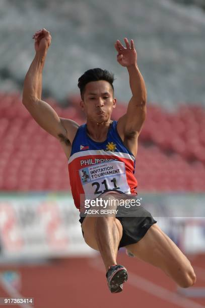 Janry Ubas of the Philippines jumps during the men's long jump final of the test event for the 2018 Asian Games in Jakarta on February 12 2018...