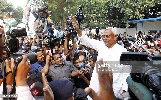 Janta Dal leader Nitish Kumar greets his supporters after landslide victory in Bihar Assembly elections at Nitish Kumar's residence on November 8...