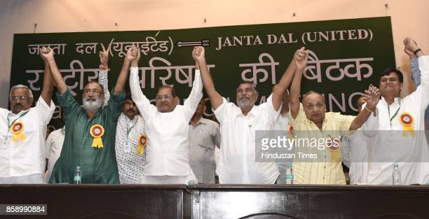 Janta Dal leader Sharad Yadav with Chhotubhai Amarsinh Vasava acting President of party with his party leaders during JD National Council Meeting on...