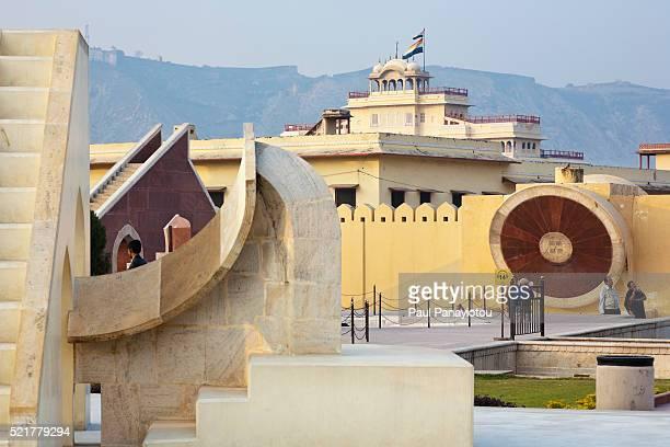Jantar Mantar Observatory and distant view of City Palace, Jaipur, Rajasthan, India