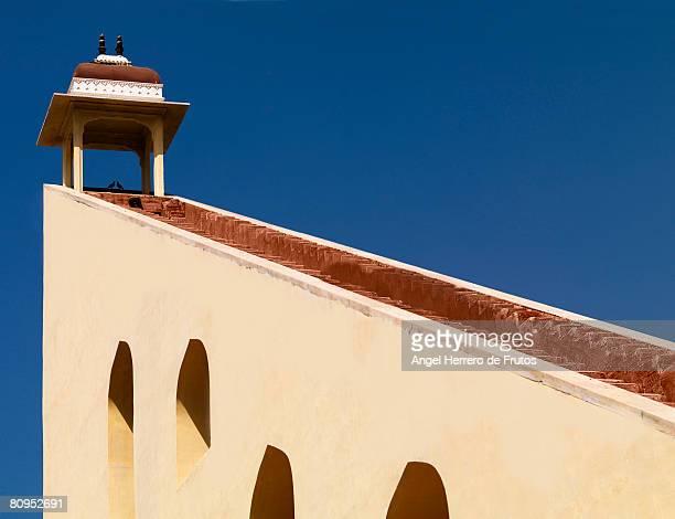 Jantar Mantar wall. Jantar Mantar is a collection of architectural astronomical instruments, built by Maharaja Jai Singh II.   Jaipur 2008