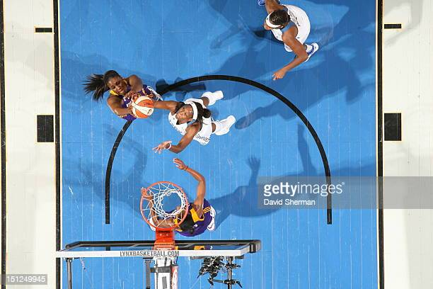 Jantel Lavender of the Los Angeles Sparks fights for a rebound against Taj McWilliamsFranklin of the Minnesota Lynx during the WNBA game on September...