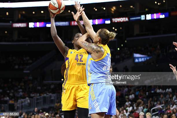 Jantel Lavender of the Los Angeles Sparks handles the ball against Erika de Souza of the Chicago Sky in a WNBA game at Staples Center on August 16...