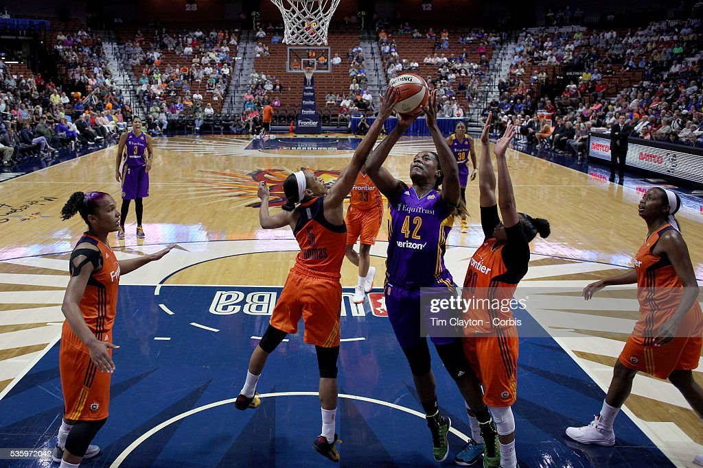 Jantel Lavender #42 of the Los Angeles Sparks has her shot blocked by Jasmine Thomas #5 of the Connecticut Sun during the Los Angeles Sparks Vs Connecticut Sun, WNBA regular season game at Mohegan Sun Arena on May 26, 2016 in Uncasville, Connecticut.