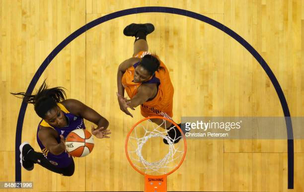 Jantel Lavender of the Los Angeles Sparks lays up a shot past Camille Little of the Phoenix Mercury during the first half of semifinal game three of...