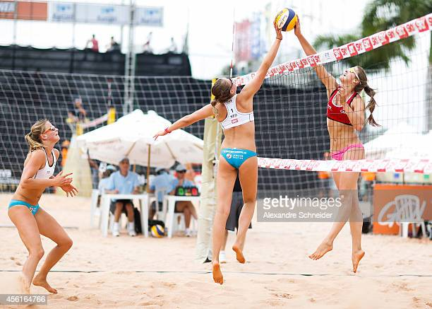 Jantine van der Vlist of Netherlands, Rimke Braakman and Taylor Pischke of Canada compete in the main draw match against United States at Jose Correa...